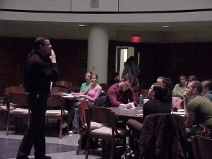 Professor Petrocelli lecturing to a group of music students about the power of hypnosis